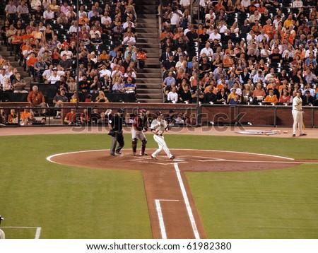 SAN FRANCISCO - SEPTEMBER 28: Diamondbacks vs. Giants: Giants Aubrey Huff lets go of bat after fouling off pitch. taken on September 28 2010 at Att Park in San Francisco California. - stock photo