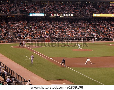 SAN FRANCISCO - SEPTEMBER 28: Diamondbacks vs. Giants: Giants Jonathan Sanchez  throws pitch to Diamondback Stephen Drew. taken on September 28 2010 at Att Park in San Francisco California. - stock photo