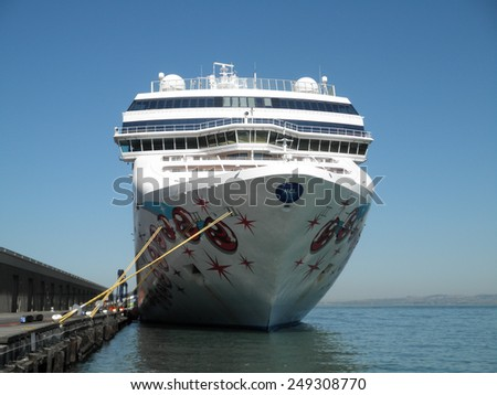SAN FRANCISCO - SEPTEMBER 28: Large Norwegian Cruise Line Cruise ship docked on pier, September 28, 2011 San Francisco.  Norwegian Cruise Line controls 8% of  worldwide share of the cruise market. - stock photo