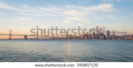 San Francisco skyline and the Bay Bridge at sunrise  - stock photo