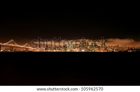 San Francisco skyline at night from treasure island with bay bridge on the left - stock photo