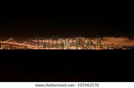 San Francisco skyline at night from treasure island with bay bridge on the left - stock photo
