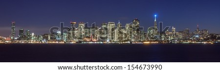 San Francisco skyline at night, with holiday season lights. - stock photo