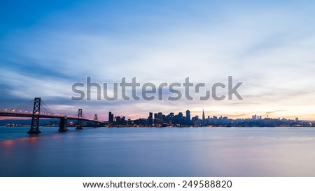 San Francisco skyline at sunset with dramatic clouds - stock photo
