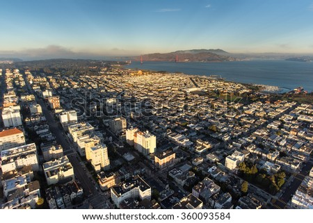 San Francisco sparkles in late afternoon light in this view looking from above Pacific Heights towards the Golden Gate Bridge. - stock photo