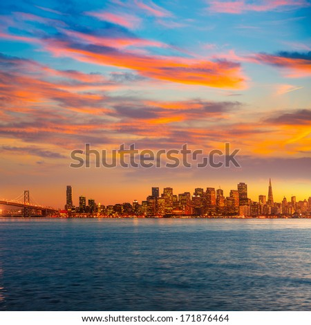 San Francisco sunset skyline in California with reflection in bay water USA - stock photo