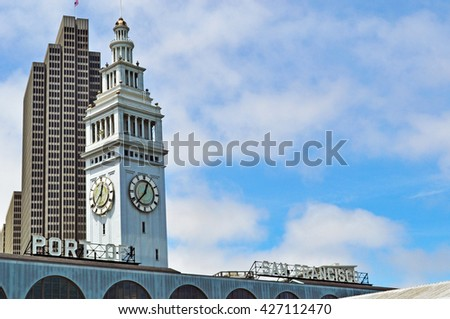 San Francisco: the clock tower of San Francisco Ferry Building on June 6, 2010. Built in 1898, the San Francisco Ferry Building is a terminal for ferries, a food hall and an office building - stock photo