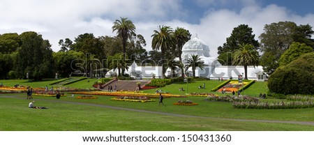 SAN FRANCISCO/USA - AUGUST 10: Historic Conservatory of Flowers is a greenhouse  that houses a collection of rare and exotic plants in Golden Gate Park, San Francisco, California.  August 10, 2013. - stock photo