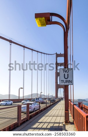 SAN FRANCISCO, USA - JULY 23, 2008:  pedestrian way at Golden Gate Bridge in San Francisco, USA with no U turn sign. - stock photo