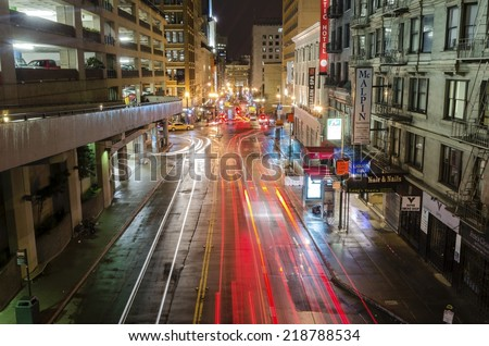 SAN FRANCISCO,USA - MARCH 1 2014: Night view of Stockton street in downtown San Francisco, California, United States of America. A view of the stores,hotels, city lights, architecture and skyscrapers. - stock photo