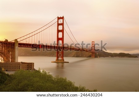 SAN FRANCISCO,USA - MARCH 1 2014: San Francisco Golden Gate Bridge in California, United States of America. The red suspended bridge connecting Frisco to Marin County at sunset against the pink sky. - stock photo