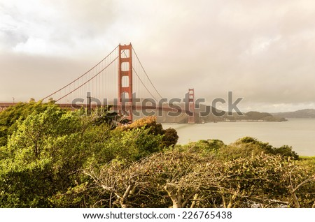 SAN FRANCISCO,USA - MARCH 1 2014: The Golden Gate Bridge in California,United States of America.View of the Bay and the red suspended bridge connecting Frisco to Marin County at sunset on a pink sky. - stock photo