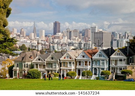 SAN FRANCISCO, USA - NOVEMBER 1, 2012: Painted Ladies in San Francisco on November 1st, 2012. It is the row of Victorian houses across Alamo Square park. The houses were built between 1892 and 1896.