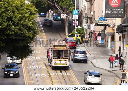 SAN FRANCISCO, USA - NOVEMBER 14, 2014: The Cable car tram. The San Francisco cable car system is world last permanently manually operated cable car system. Lines were established betw. 1873 and 1890. - stock photo