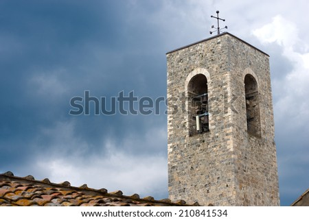 San Gimignano - Siena Tuscany Italy / Bell tower of the Cathedral of San Gimignano (santa maria assunta) medieval town (UNESCO heritage), Siena, Tuscany, Italy - stock photo