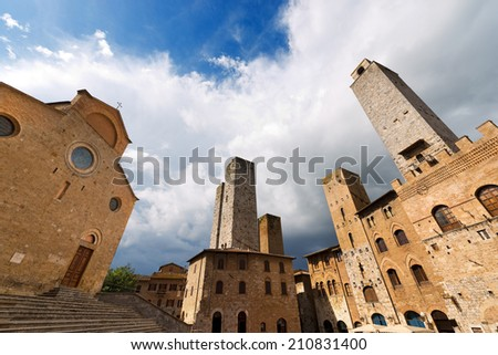 San Gimignano - Siena Tuscany Italy / Buildings and towers in Piazza del Duomo, San Gimignano medieval town (UNESCO heritage), Siena, Tuscany, Italy - stock photo