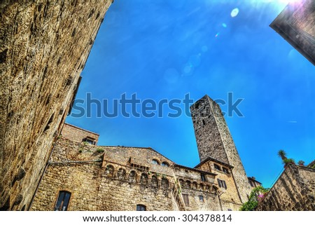 San Gimignano tower under a clear sky. Processed for hdr tone mapping effect. - stock photo
