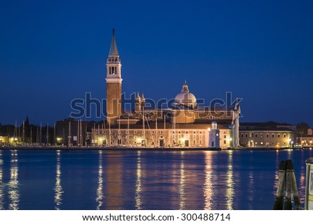 San Giogio Maggiore church and monastery at night, with reflections in the Grand Canal, Venice, Italy - stock photo