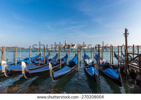San Giorgio Maggiore Church and gondolas on Grand Canal in Venice, Italy. - stock photo