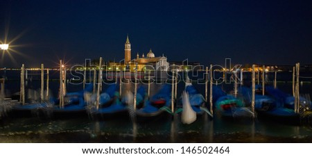 San Giorgio Maggiore church Long exposure By Night. Blurred motion Gondolas due to Grand Canal sea movement.