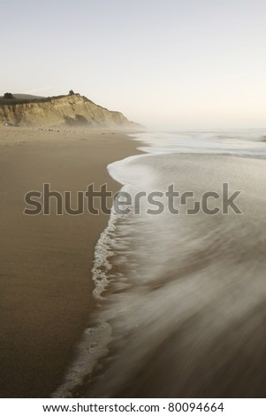 San Gregorio Beach and cliffs, California State Beach and Wildlife Preserve, at sunset - stock photo