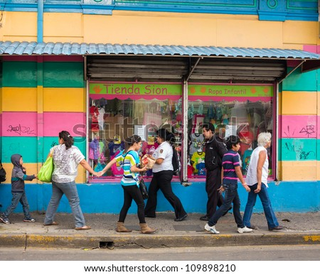 SAN JOSE, COSTA RICA - CIRCA AUGUST 2012: Typical street scene with locals, circa 2012 in San Jose, a very popular tourist destination with 2.2 million foreign visitors a year. - stock photo