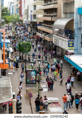SAN JOSE, COSTA RICA - CIRCA AUGUST 2012: View of the Avenida Central Street circa 2012 in San Jose, a very popular tourist destination with 2.2 million foreign visitors a year. - stock photo
