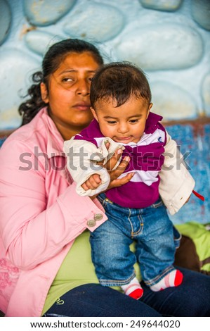 SAN JOSE, COSTA RICA - JAN 6, 2012: Unidentified Costa Rican mother and her baby. 65.8% of Costa Rican people belong to the White (Castizo) ethnic group