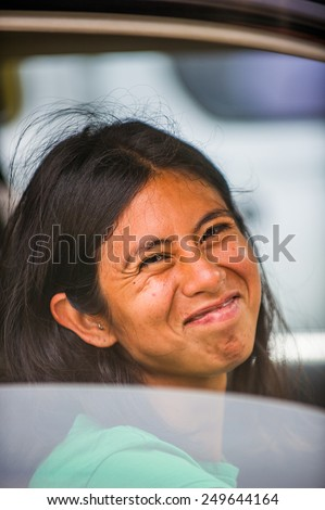 SAN JOSE, COSTA RICA - JAN 6, 2012: Unidentified Costa Rican woman smiles out the car. 65.8% of Costa Rican people belong to the White (Castizo) ethnic group