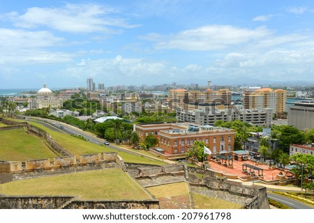 San Juan City Skyline, from top of Castillo San Cristobal, San Juan, Puerto Rico. Castillo San Cristobal is designated as UNESCO World Heritage Site since 1983. - stock photo