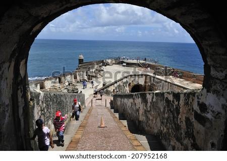 San Juan, Puerto Rico, - June. 18. 2010: tourist visiting in Castillo San Felipe del Morro, a 16th-century fortress in San Juan, Puerto Rico, designated as UNESCO World Heritage Site in 1983. - stock photo