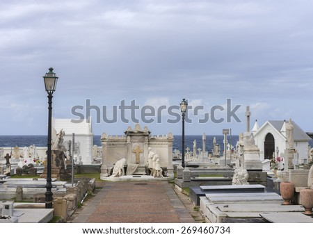 SAN JUAN, PUERTO RICO - MARCH 14, 2015: Central statue at the historic cemetery, located on the shore of the ocean near Castello San Felipe del Morro.