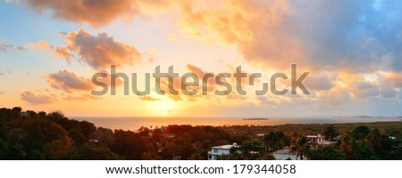 San Juan sunrise panorama view with colorful cloud and beach coastline.  - stock photo