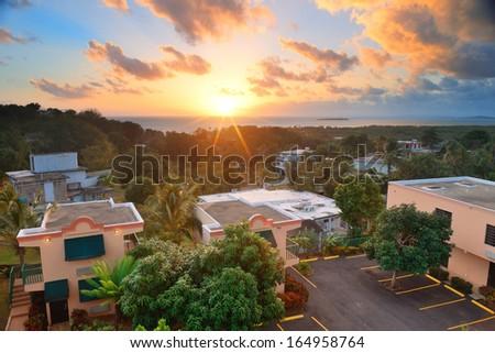 San Juan sunrise with colorful cloud, buildings and beach coastline.  - stock photo