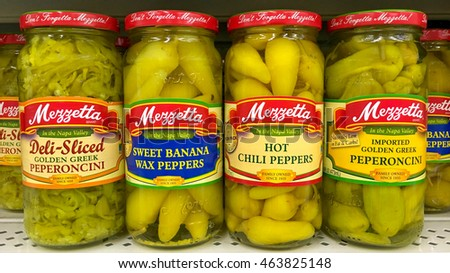San Leandro, CA - August 01, 2016: Grocery Store Shelf with jars of Mezzetta brand peppers in a variety of flavors.  Mezzetta is a private owned American company founded in California in 1935.