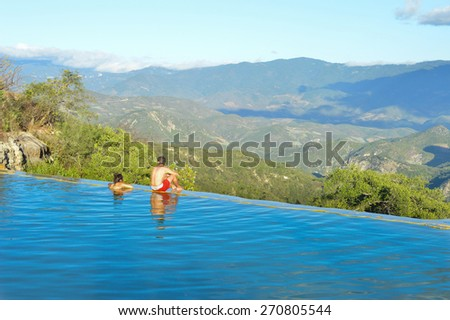 San Lorenzo Albarrades, Oaxaca State, Mexico - November 15, 2014: People chilling in the pools of the Hierve el agua hot springs near Oaxaca on November 15, 2014 - stock photo