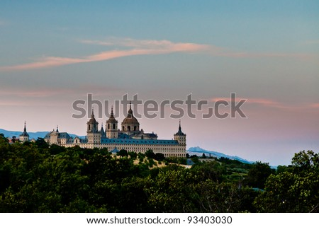 San Lorenzo de El Escorial Monastery from a distance with beautiful sky right after sunset.