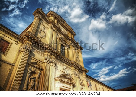 San Marco church under a dramatic sky in Florence, Italy - stock photo