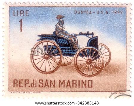 "SAN MARINO - CIRCA 1962: A stamp printed in San Marino shows Old auto with the inscription ""Duryea, USA, 1892"", circa 1962 - stock photo"