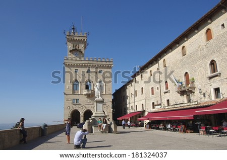 SAN MARINO, Italy - OCTOBER 04: Liberty statue and Public Palace on October 04, 2011 Republic San Marino. Tourists visiting Liberty statue and Public Palace in sunny autumn day