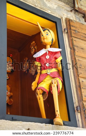 SAN MARINO. SAN MARINO REPUBLIC - AUGUST 08, 2014:  Pinocchio in the window  building store of wooden toys in San Marino. The Republic of San Marino - stock photo