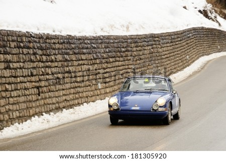 SAN MARTINO DI CASTROZZA, ITALY - FEBRUARY 22: A blue Porsche 911 S takes part to the WinteRace classic car race on February 22, 2014 in San Martino di Castrozza. This car was built in 1967. - stock photo