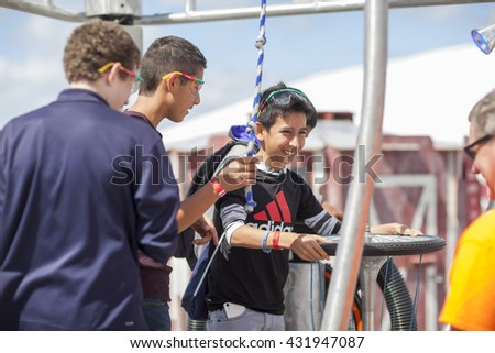 SAN MATEO, CA May 20 2016 - A boy and his friends operate an interactive art piece during the 11th Annual Bay Area Maker Faire at the San Mateo County Event Center.