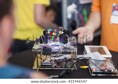 SAN MATEO, CA May 20 2016 - A demonstration of a Rubik's Cube solving machine during the 11th annual Bay Area Maker Faire at the San Mateo County Event Center.