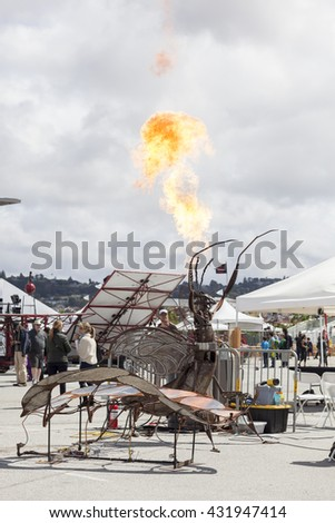 SAN MATEO, CA May 20 2016 - An interactive art piece spouts fire during the 11th Annual Bay Area Maker Faire at the San Mateo County Event Center.