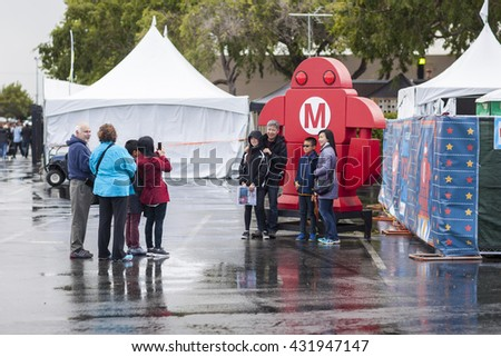 SAN MATEO, CA May 20 2016 - Attendees snap a group photo during the 11th annual Bay Area Maker Faire at the San Mateo County Event Center.