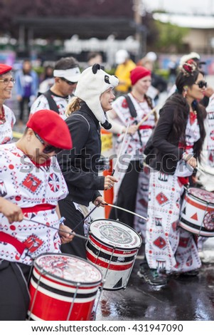SAN MATEO, CA May 20 2016 - Batala warms up the crowd after a rainy start to the Saturday session of the 11th annual Bay Area Maker Faire at the San Mateo County Event Center. - stock photo