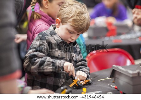 SAN MATEO, CA May 20 2016 - Children work during a free build activity at the 11th annual Bay Area Maker Faire at the San Mateo County Event Center.