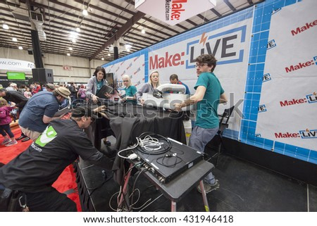 SAN MATEO, CA May 20 2016 - Glowforge employees disassemble their presentation equipment at the 11th annual Bay Area Maker Faire at the San Mateo County Event Center. - stock photo