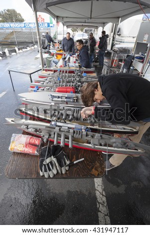 SAN MATEO, CA May 20 2016 - RC battleships being preparedat the battle pond during the 11th annual Bay Area Maker Faire at the San Mateo County Event Center.